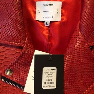 Cardi B red snake skin drench coat